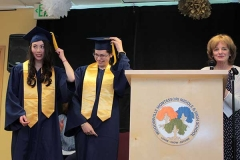 Mary presents the grads, and they flip their tassels!