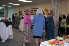 Families, friends, faculty, staff and board members mingled at a reception following the ceremony.