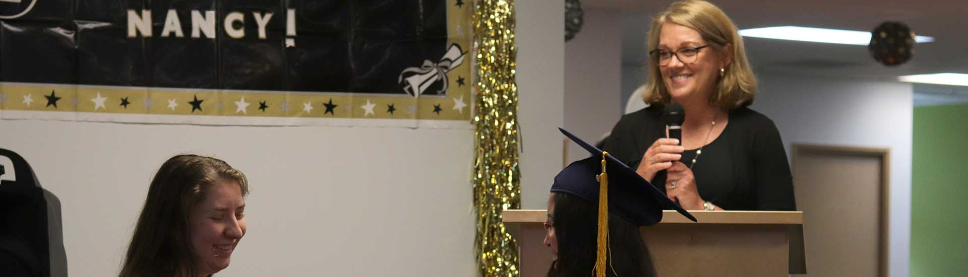 Wendy Coulombe speaks at the 2019 graduation